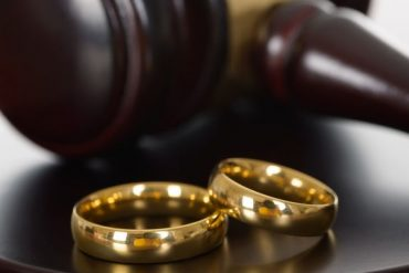 wedding bands and a gavel
